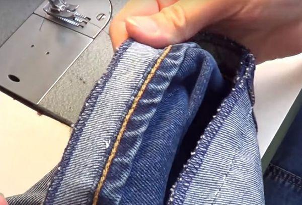Укорачивание длинны брюк на машинке