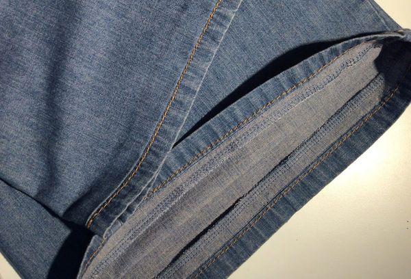 Подшитые брюки с сохранением фабричного шва